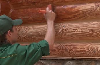 Покраска стен бревенчатого дома